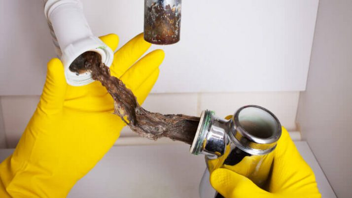 Funky Smell and Standing Water: How to Clear a Clogged Drain