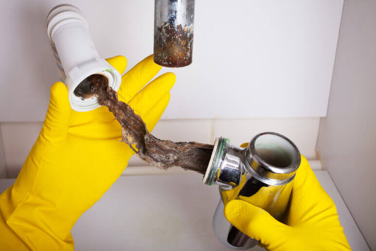 how to clear a clogged drain